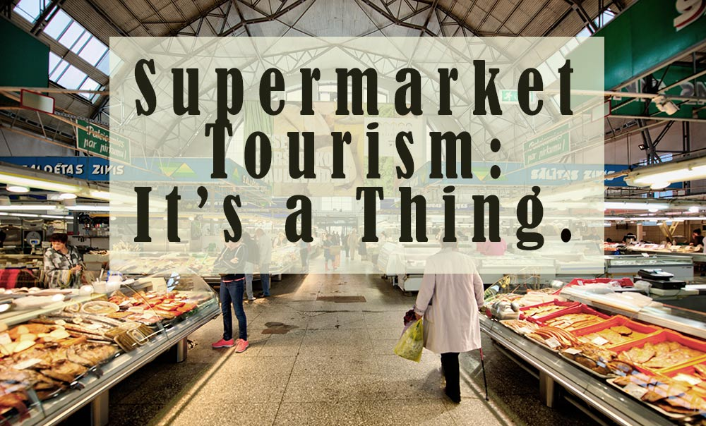 "A picture of a supermarket cold food aisle with the words ""Supermarket Tourism: It's a Thin"" superimposed over it."