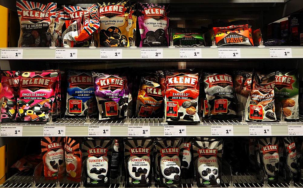 "Shelves full of packages of Dutch ""drop,"" or licorice, in various shapes and degrees of sweetness or saltiness"