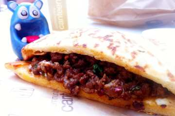 Spicy Lamb on Naan Bread from Community Canteen