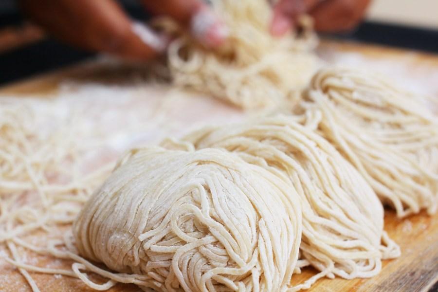 Chef making egg noodles