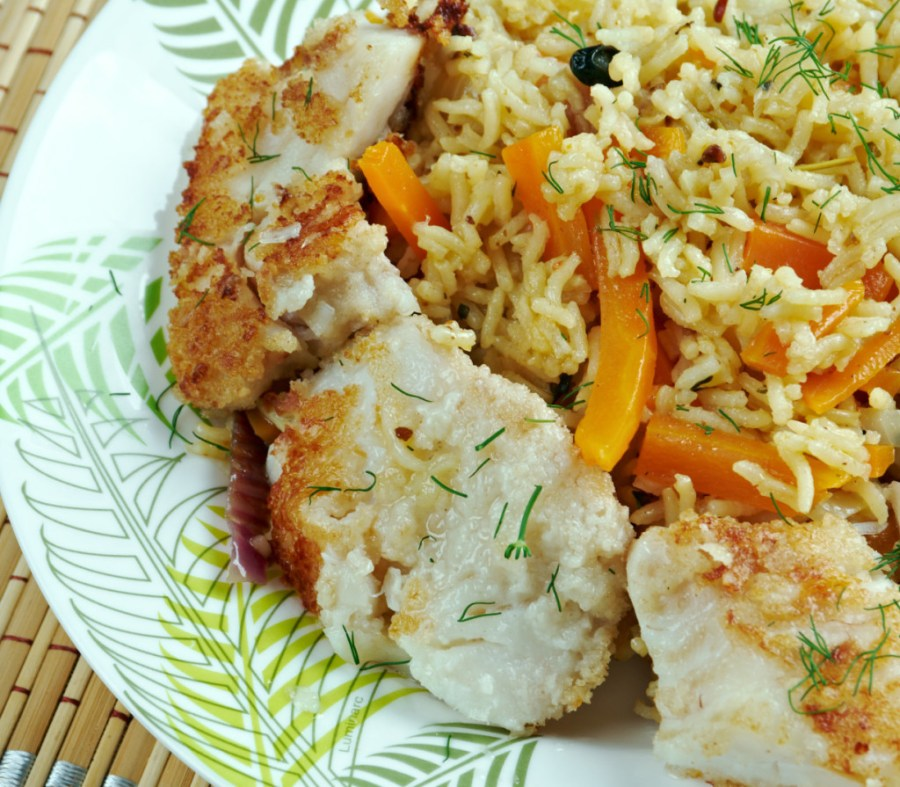 Azerbajian balık plov - a golden burnt rice crust features prominently in this fish pilaf dish.