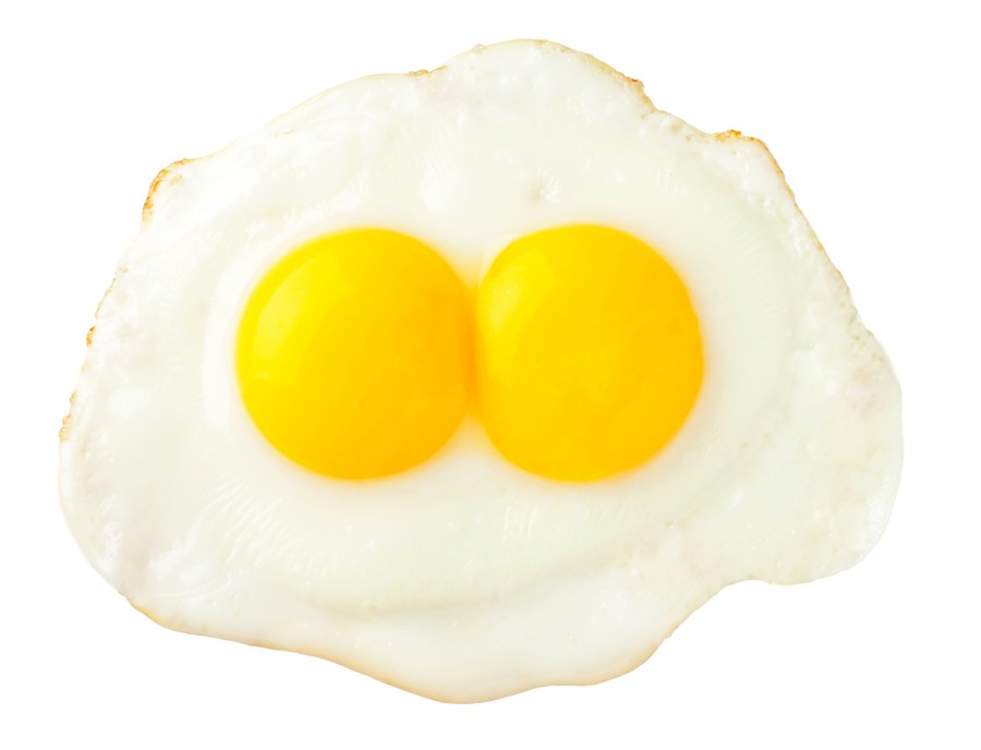denaturation - Fried eggs that look like funny face isolated on white background