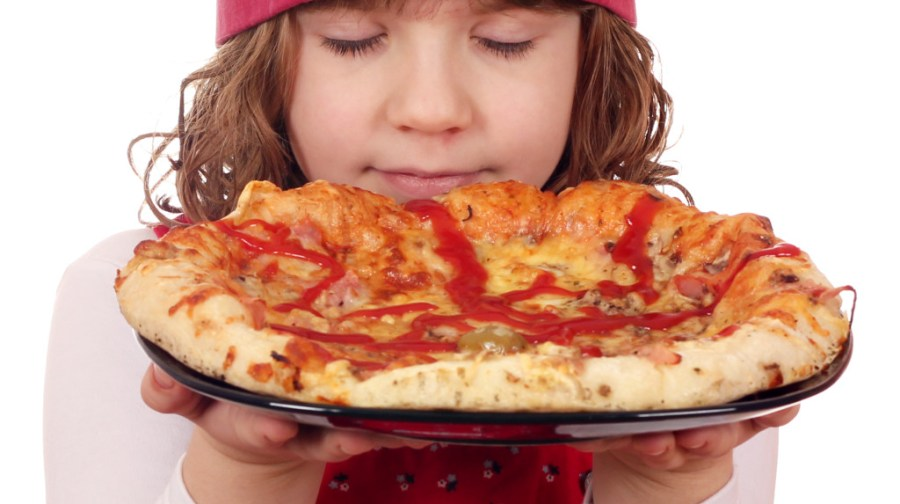 little girl cook smells pizza
