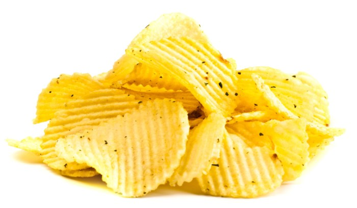 Handful of yellow potato chips isolated on white background