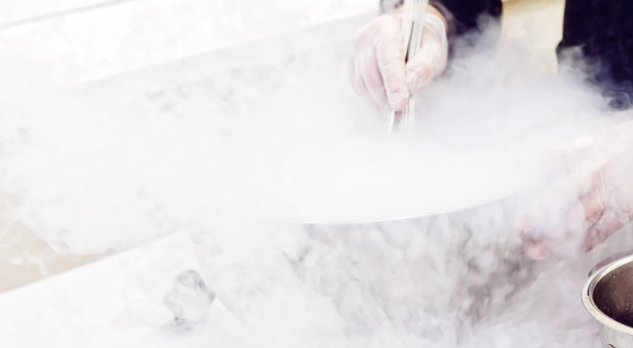 Chef is cooking ice cream with liquid nitrogen, toned