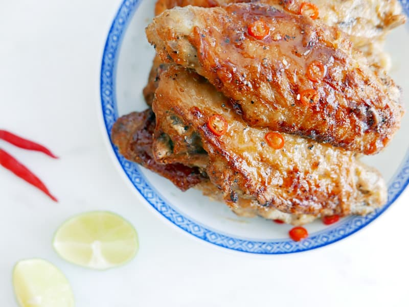 This Vietnamese Spicy Caramel Turkey Wing recipe is easy, big on flavour, yet quick to make! This simple oven turkey wing recipe is rich and tangy. Nomss.com #vietneameserecipe #turkeyrecipes #spicywings #wingrecipe #mealprep #kidsmeals