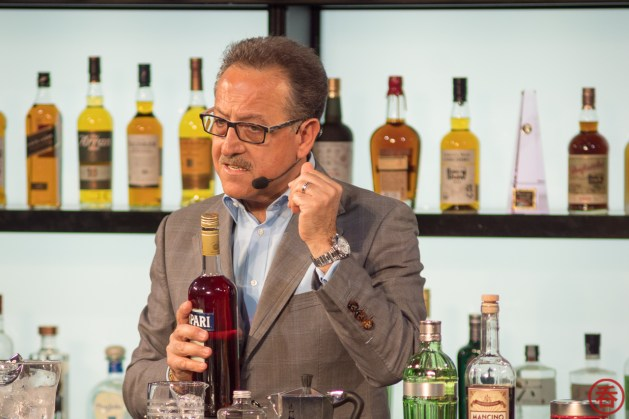 Salavatore Calabrese on stage showing how to make a proper Negroni