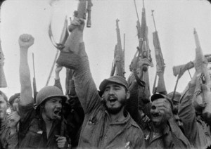 Castro holding a gun in victorious gesture