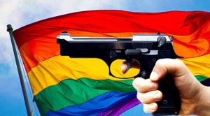 Gun in front of rainbow flag
