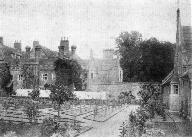 A photograph of the South-West side of the old house taken in the 1870's. The stable-yard buildings are off to the right