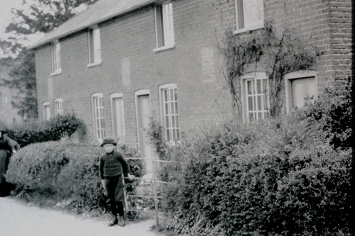 An early 1900's view of the four cottages [now three] in Holt Street Row.