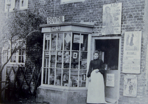 Easole-Mrs Hill in shop door-way