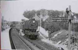 Snowdown and Nonington Halt, Dover bound platform, in the 1950's. Snowdown Colliery loco shed is just behind the engine  in mid-picture