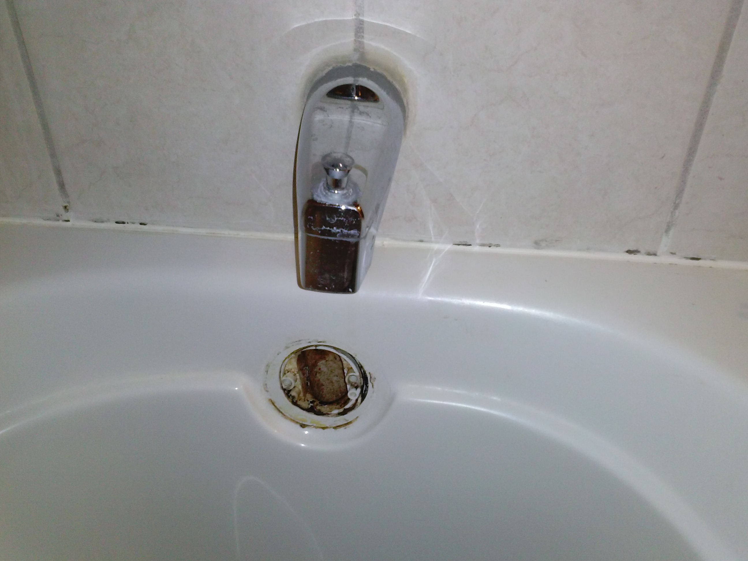 cleaning overflow drain bathroom sink how to clean out a tub drain no nonsense landlord 22938