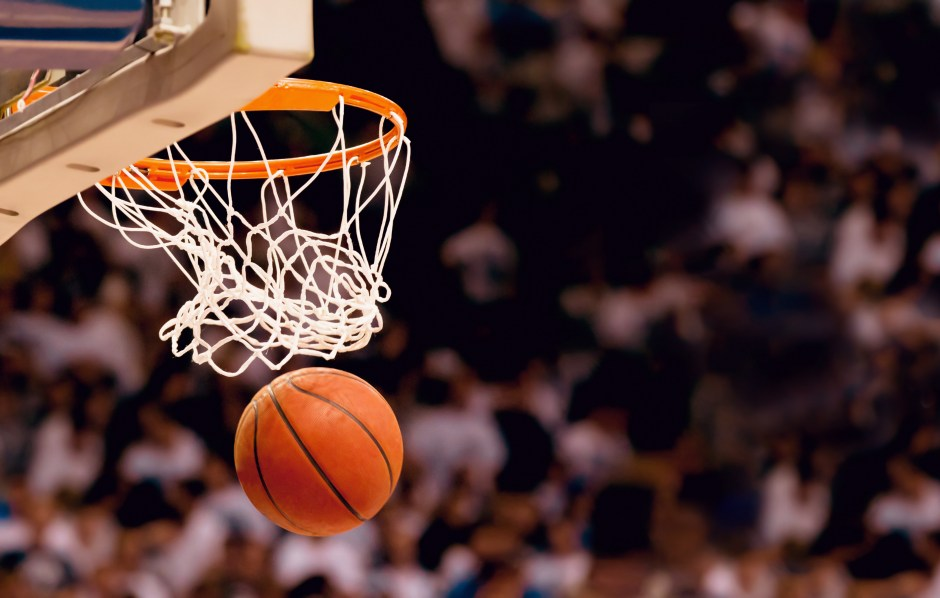Scoring the winning points at a basketball game