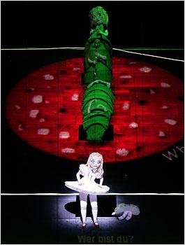 """Sally Matthews (Alice) and Stefan Schneider (Caterpillar) in """"Alice in Wonderland"""""""