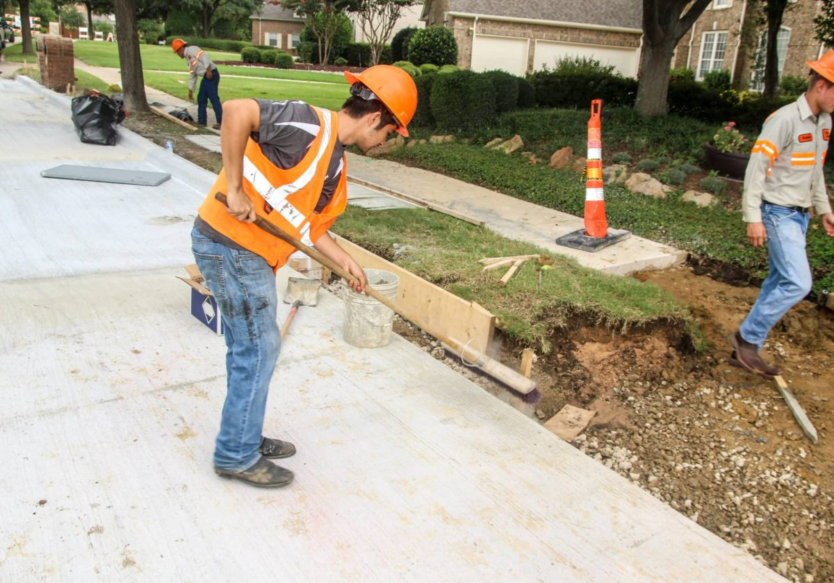Pouring cement during Upgrade to residential street in Dallas-Fort Worth