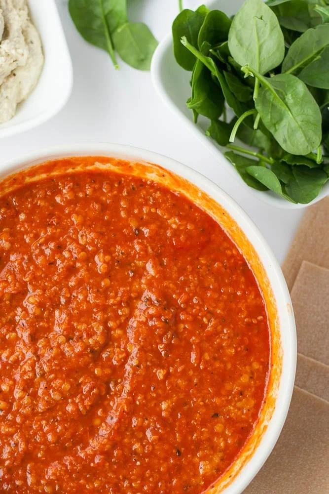 bowl of red lentil marinara for vegan lasagna