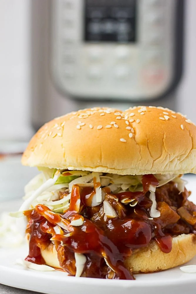 Instant Pot Pulled BBQ Jackfruit sandwich with coleslaw on top