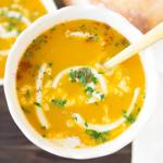 vegan butternut squash soup in a bowl with cream