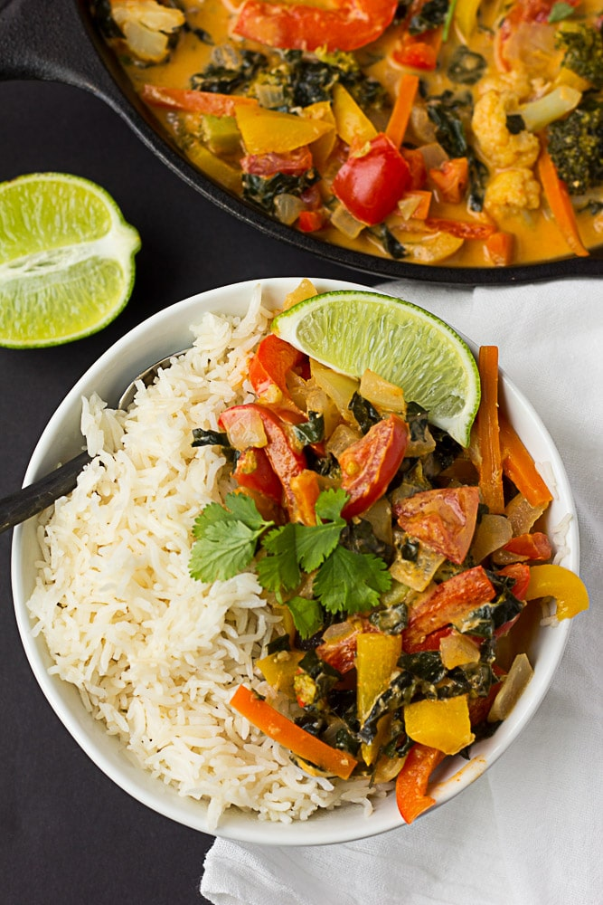 Red Thai Curry Vegetables in small bowl with white rice looking down onto it.