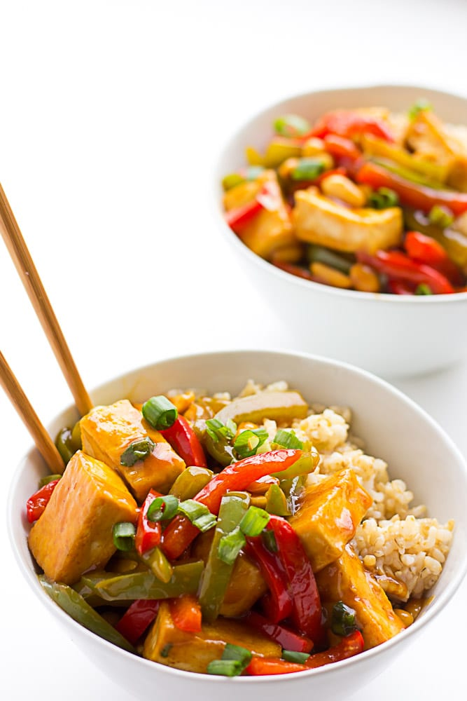 kung pao tofu in bowls on top of rice