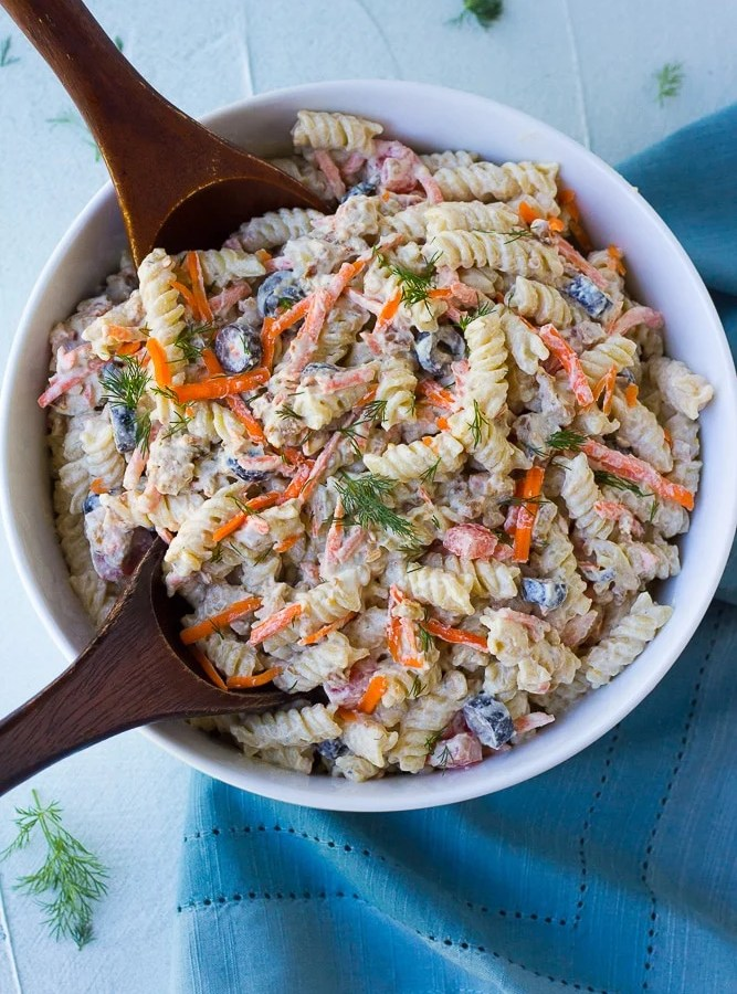 bacon ranch vegan pasta salad in a bowl with wood spoons