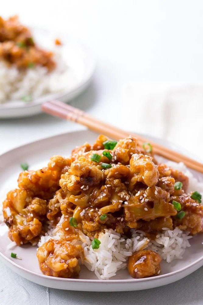 sesame cauliflower on a plate with chopsticks
