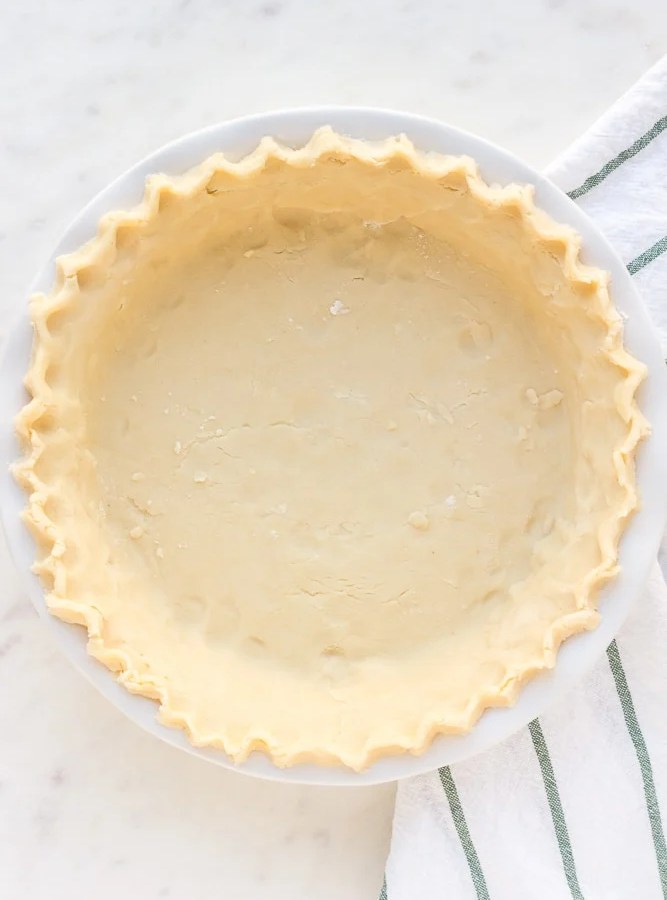 finished vegan pie crust with fluted edges, not cooked