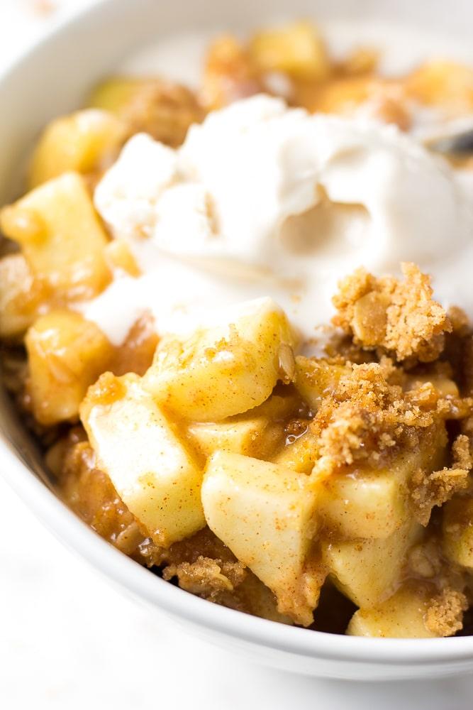 close up shot of vegan apple crisp with soy vanilla ice cream