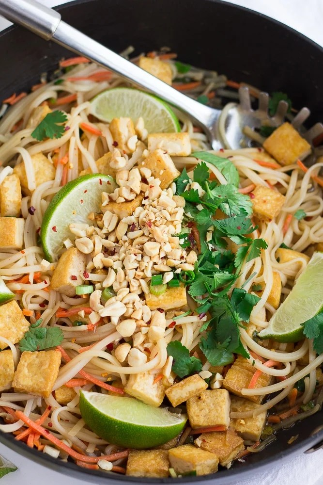 Vegan Pad Thai in a pan, with crushed peanuts on top