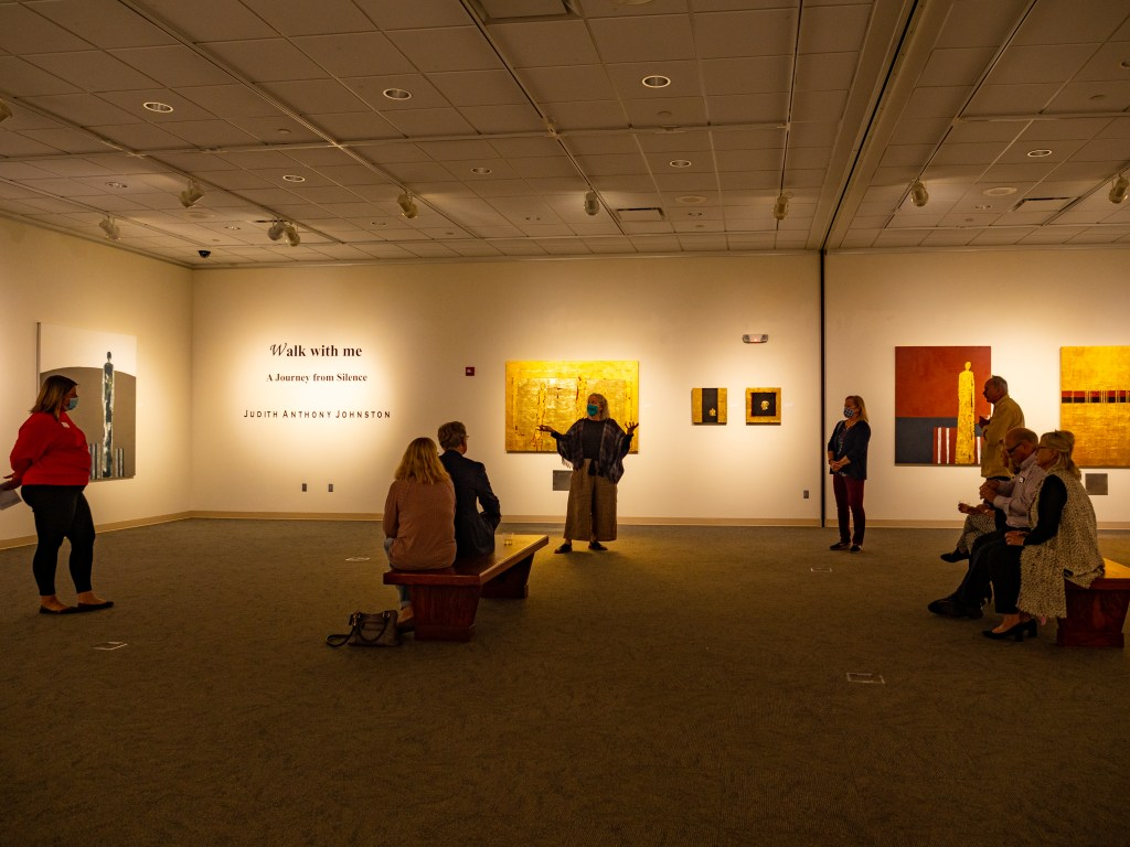 Judith Anthony Johnston speaking to a group in the gallery.
