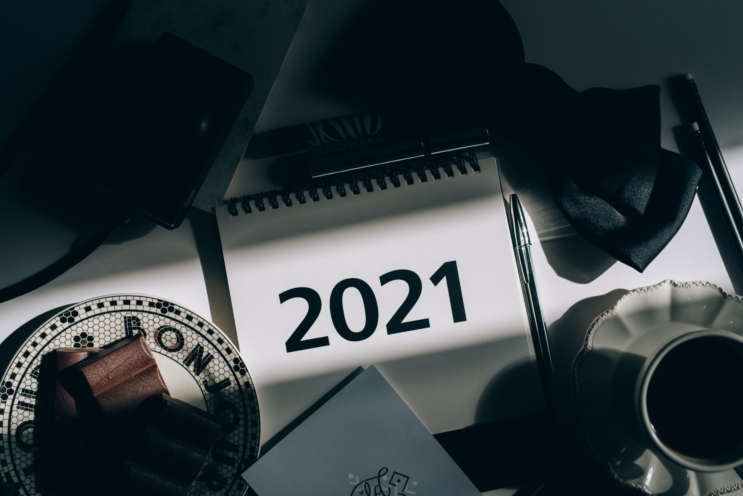 The number 2021 on a binder on a desk, highlighting the new year