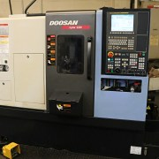 Doosan Lynx 220A CNC Turning Center with ATS EC-565 Barfeeder