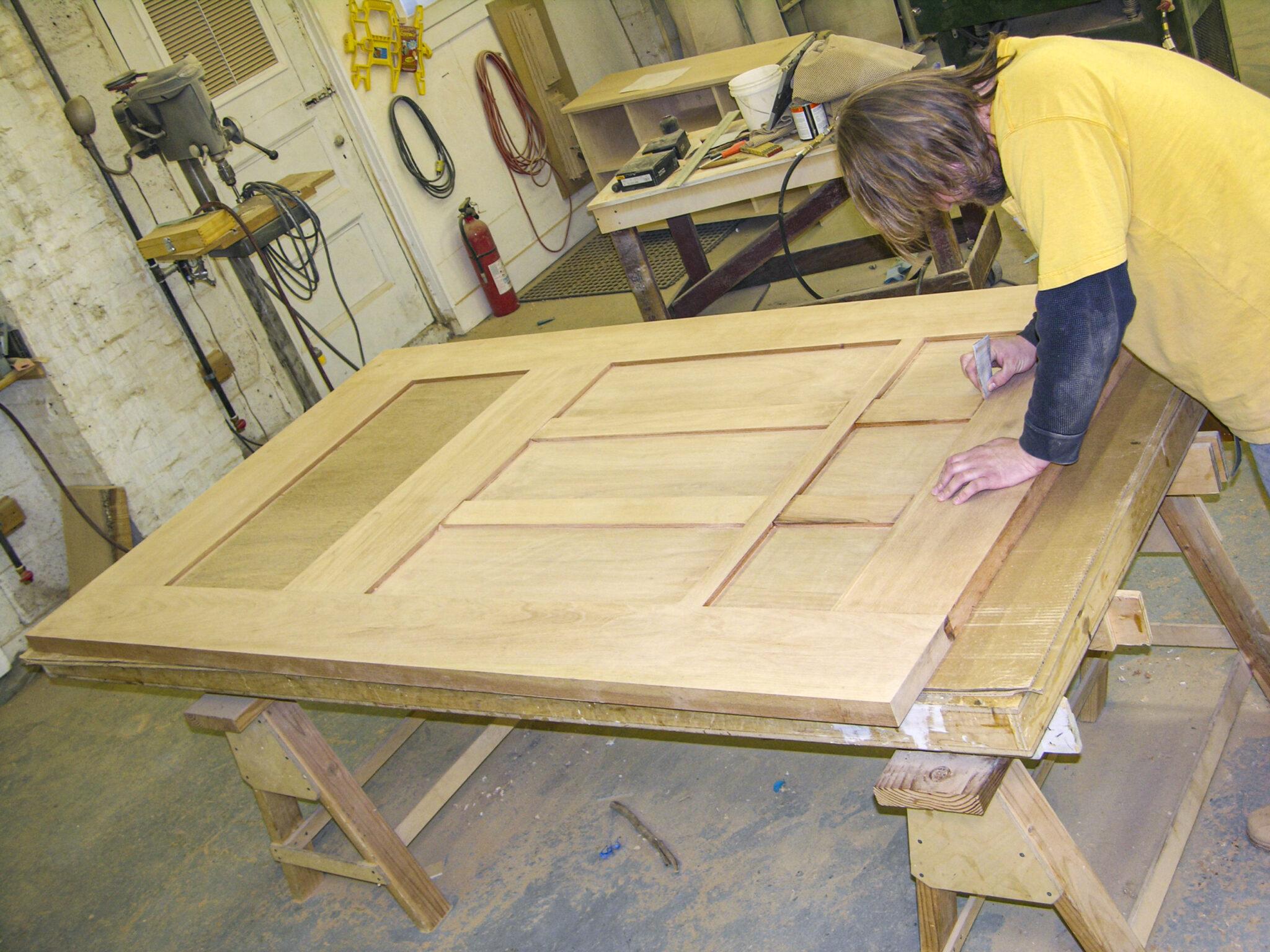 craftsman sanding custom door