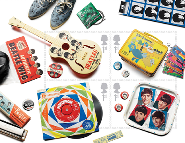Royal Mail Miniature sheet of 1st class Beatles stamps showing memorabilia - guitar, luchbox, 45rpm single, tea tray.