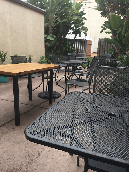 Ty's Burger House garden seating with tables and chairs