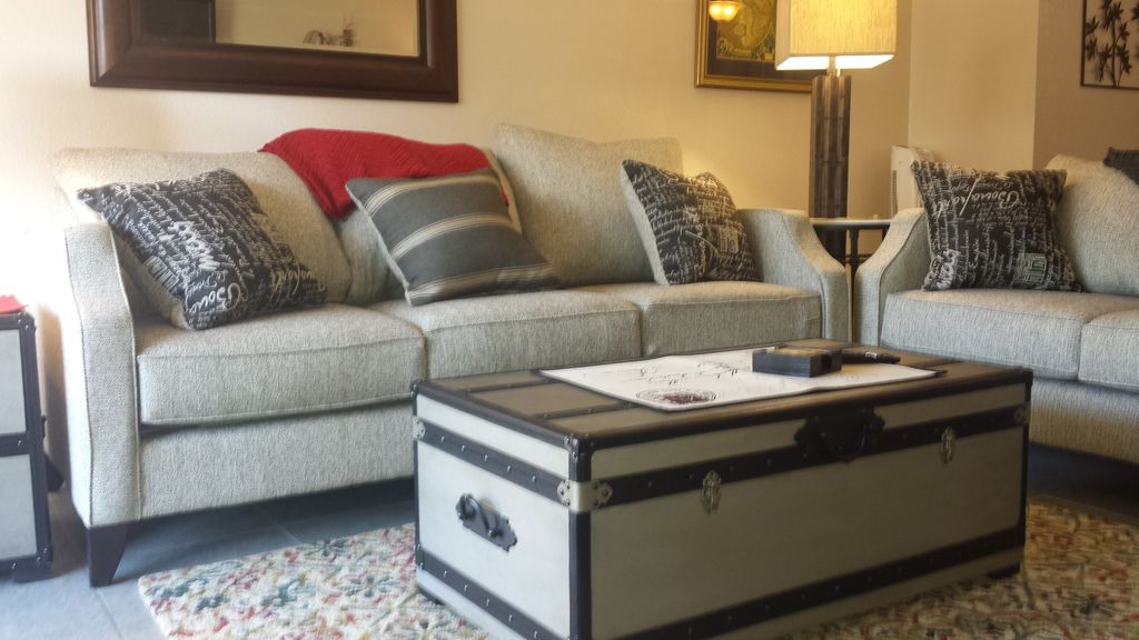 a17 light grey sofa and trunk used as coffee table