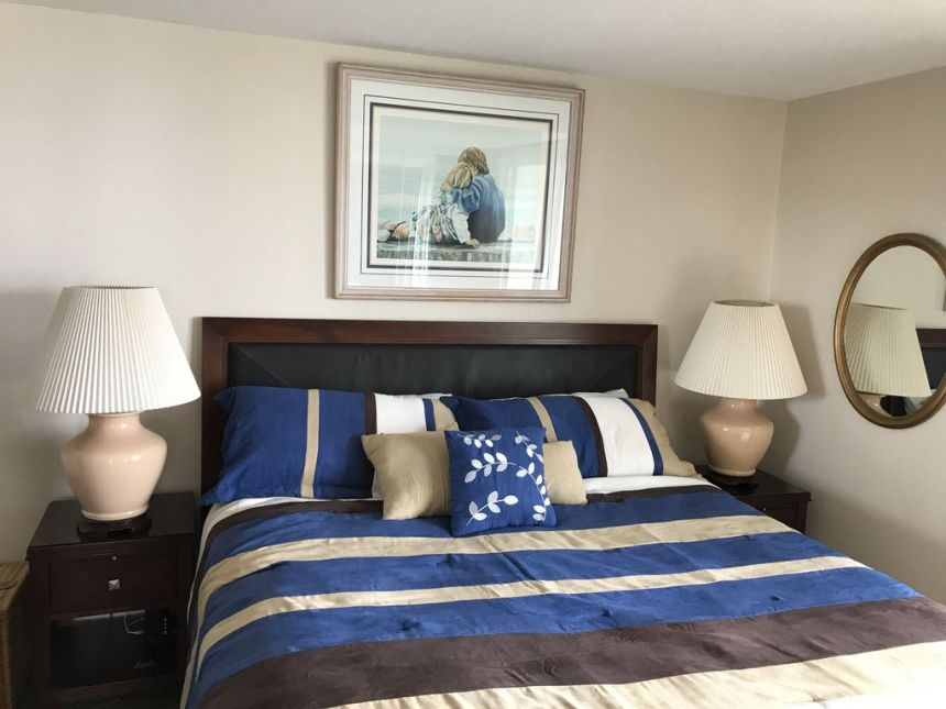 a201 blue and brown striped comforter on a king size bed