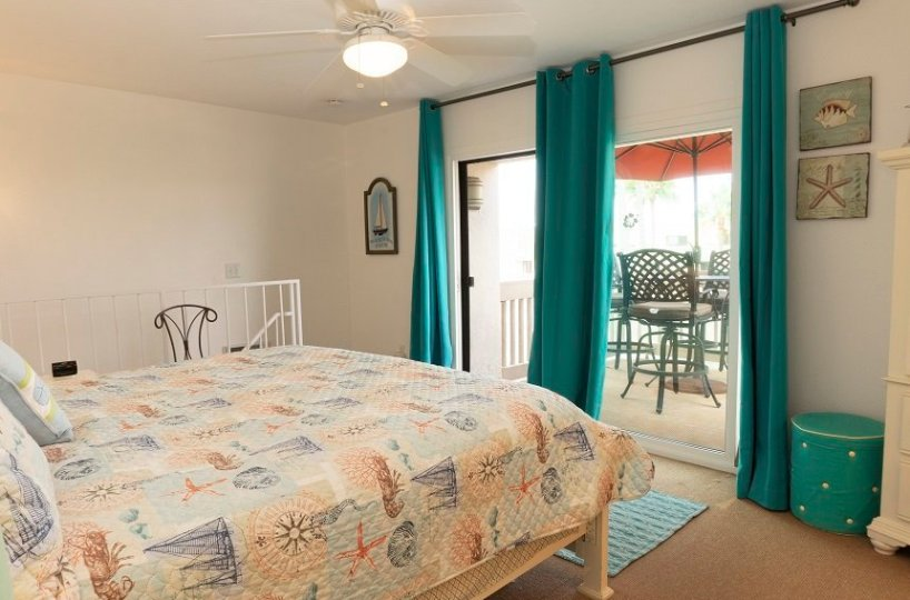 D-305 Upstairs bedroom with view sliding class door onto balcony