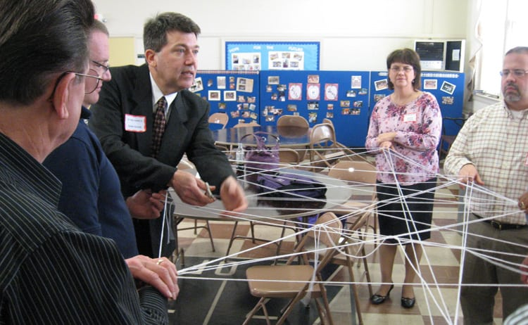 VA Chaplain John Oliver cuts the web woven by rural pastors at a Department of Veterans Affairs sponsored training last week.