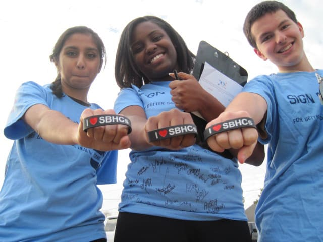 Members of Youth Empowered Solutions show their support for a school-based health clinic in Wake County