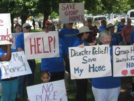 A crowd of about 70 people from group homes, their family members and facility staff turned out to rally in front of the Legislature Wednesday.