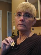Donna Reeves shows the locket she wears that contains an image of her daughter Casey.
