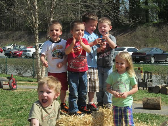 Kids at Lulu's Child Enrichment Center find plenty of entertainment climbing on hay bales.