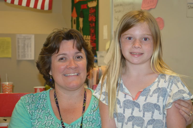 Manteo Elementary second grade teacher Tricia Tawes and her former student Lexi Rule in her classroom. Tawes' class participated in Peer Power last school year. Photo credit: Jasmin Singh
