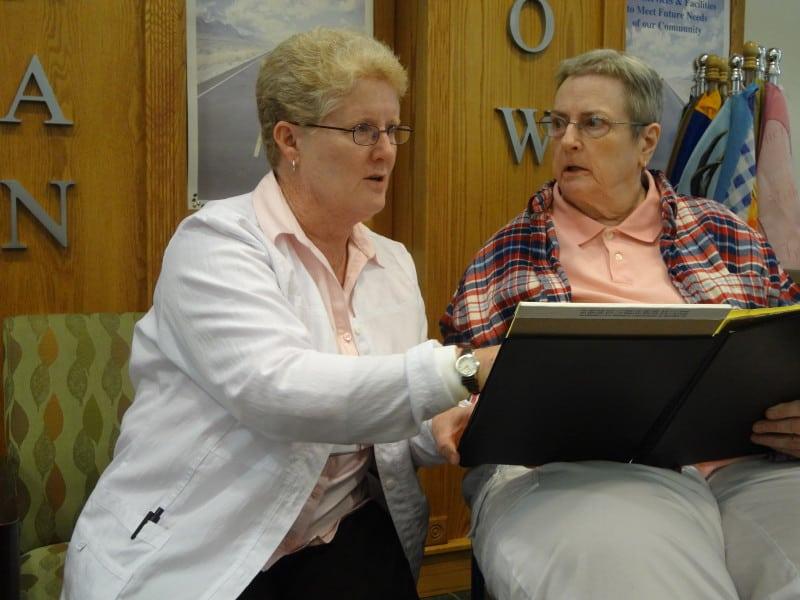 Jean Matthews, left, partners with Jeneil Parker to better coordinate Parker's health care.