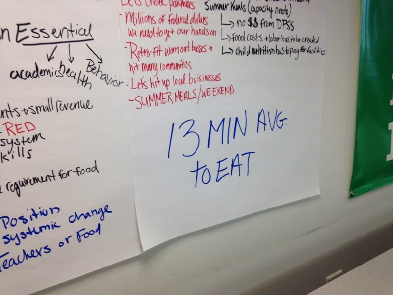 """Durham student food service director James Keaten made the point that kids only have an average of 13 minutes scheduled to get in line, get their trays filled, sit down and eat their lunches in most schools. Photo shows a handwritten sign reading """"13 minutes to eat"""""""