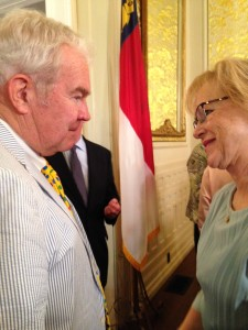 HHS Secretary Aldona Wos is greeted by Sen. Louis Pate (R-Mt. Olive) after she announced her impending resignation.