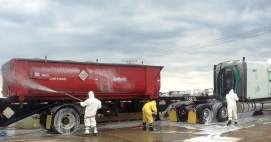 Tires, undercarriage, and the roll-off container are disinfected and washed as a biosecurity precaution.